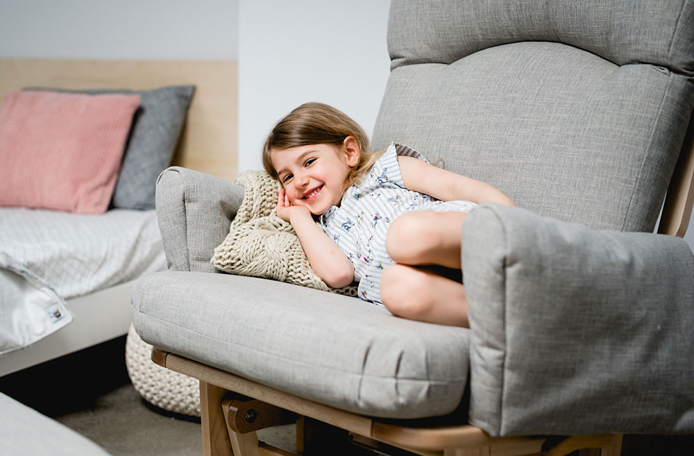 child in a gliding chair